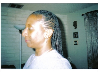 cornrows in front and singles in back I did