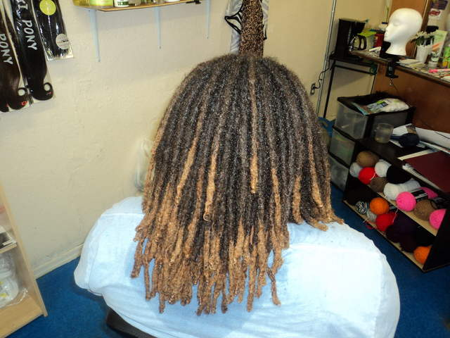 Interlocking Dreads: I interlocked his new growth