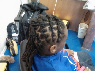 locs i did flat twisted to the side
